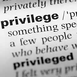 Close up of dictionary definition of privilege